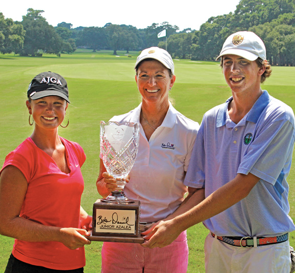 Winners Anne Taylor Hough and Trace Crowe with Beth Daniel